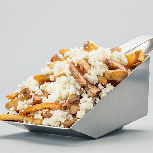 Big cut french fries with cheese on top